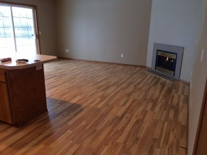 Finished Corvallis, OR Hardwood Flooring in Room with Fireplace